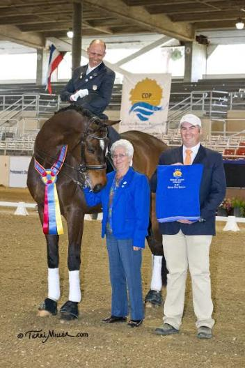 Steffen Peters and Legolas accept congratulations from judge Cara Whitham (5* CAN) and California Dressage Society President Kevin Reinig for the Grand Prix Special at the Mid-Winter Dressage Fair CDI-W. (Photo: Terri Miller)