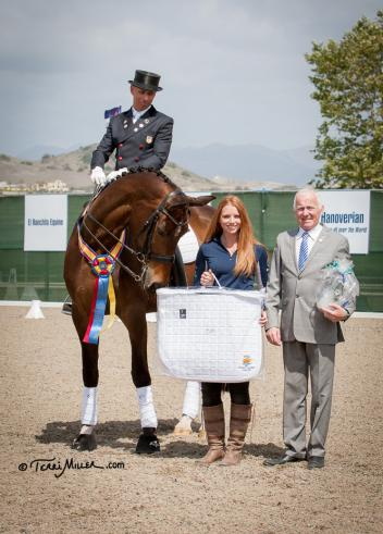 Steffen Peters and Rosamunde celebrate their Prix St. Georges win with class sponsor Haley Dwight of Professionals' Choice and judge Bo Ahman (4* SWE) at the Capistrano Dressage International CDI-W. (Photo: Terri Miller)