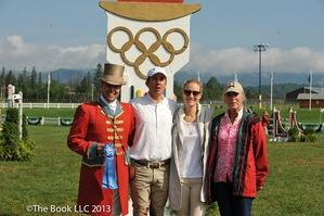 Philip Richter after his win with ringmaster Alan Keeley and his wife Sarah and his mother Judy