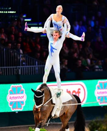 Germany's Pia Engelberty and Torben Jacobs on Danny Boy, lunged by former world champion Patric Looser, notched up their second victory in this year's FEI World Cup™ Vaulting in Leipzig, winning both rounds and guaranteeing their ticket to the Final in Bordeaux on 7-8 February. (Photo: Pascal Duran/FEI)