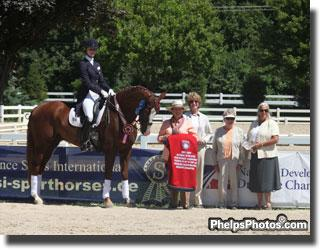 Caroline Roffman and Pie in the winner's circle for the Reserve Championsip in the Developing Horse division spnsored by J. Tim Dutta and PSI Sales International