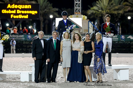 Adrienne Lyle in her winning podium presentation with Equestrian Sport Productions' Michael Stone, Allyn Mann of Adequan, Tuny and Charlotte Page of Stillpoint Farm, Cora Causemann of ESP, and President of the Ground Jury Anne Gribbons Photo: SusanJStickle