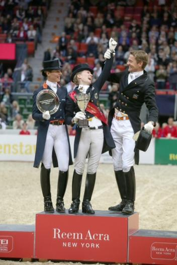 Having fun on the podium at the Reem Acra FEI World Cup™ Dressage Final in Gothenburg, Sweden today - L to R - runner-up Adellinde Cornelissen NED, new Reem Acra champion Helen Langehanenberg GER and Edward Gal NED who finished third. (Photo: FEI/Roland Thunholm)