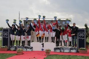 On the podium for the Young Riders Team Championship at the FEI European Jumping Championships for Children, Juniors and Young Riders 2014 at Arezzo, Italy: (L to R) the silver medallists from Norway, the gold medallists from Germany and the bronze medallists from Italy.  Photo: FEI/Stefano Secci.
