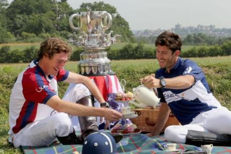 England captain Luke Tomlinson and American captain Nic Roldan (R) pose during a tea party prior to England competing against the USA in the Audi International Polo Westchester Cup on July 5, 2013 in Windsor, England. (Photo by Chris Jackson/Getty Images for Audi)