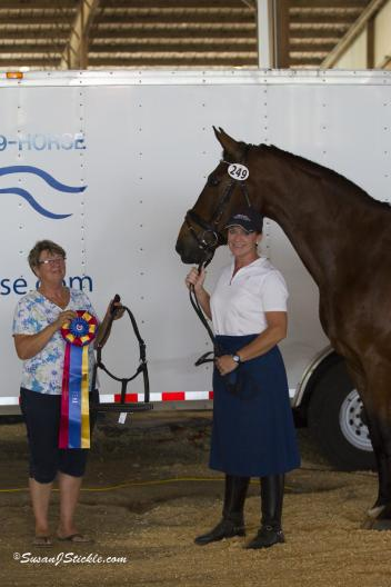 Christy Raisbeck and Fernando won The Horse of Course High Score Award at the Houston Dressage Society Spring Classic I show. Beth Haist presents the award. (Photo: SusanJStickle.com)