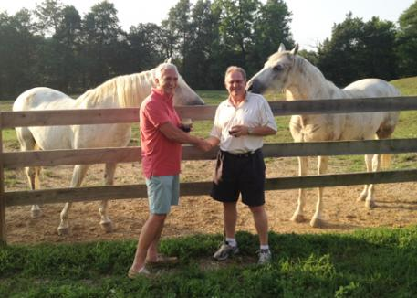 Ralph Graham of Hawk's Haven Farm and Keith Manfred of YS Nutrition celebrate the new sponsorship for Equine D a product bringing added value and quality of life to the retirees Ralph cares for on his farm in Glens Fork, Kentucky