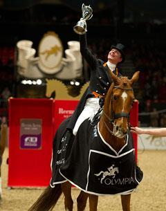 The Netherlands' Adelinde Cornelissen celebrates her second successive win in the 2010/2011 Reem Acra FEI World Cup™ Dressage series with Jerich Parzival at Olympia in London (GBR) tonight.  Photo: Kit Houghton/FEI