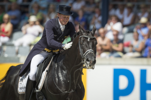 Matthias Alexander Rath and Totilas led the German team to victory in the FEI Nations Cup™ Dressage 2014 pilot series on home ground in Aachen. (Photo: FEI/Dirk Caremans)