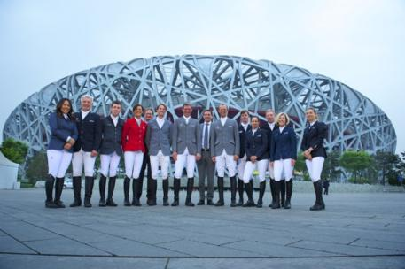 """The group photo shows the international riders together with Michael Mronz and Frank Kemperman in front of the """"Bird`s Nest"""" Olympic Stadium (f.t.l.): Meimei Zhu (CHN), Roger-Yves Bost (FRA), Scott Brash (GB), Penelopes Leprevost (FRA), Frank Kemperman (NL), Kevin Staut (FRA), Ludger Beerbaum, Michael Mronz, Marco Kutscher (all from Germany), Ben Maher (GB), Laura Kraut (USA), Nick Skelton (GB) and Jane Richard Philips (SUI). Photo: Arnd Bronkhorst"""