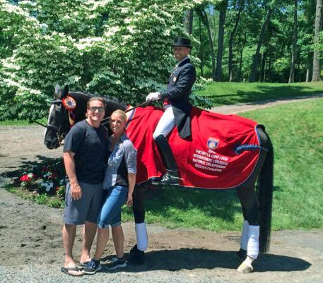 Jeremy and Tracy Roenick with Steffen Peters and their reserve champion mare Apassionata