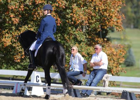 Christine Traurig on the US High performance Committee and Johann Hinnemann admire Her Highness O and Caroline Roffman warming up for the Intermediaire 1 Freestyle at the USEF Dressage National Championships Photo: Mary Phelps