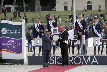 The Ukrainian team on the podium at Piazza di Siena in Rome (ITA) today after winning the seventh leg of the Furusiyya FEI Nations Cup™ Jumping 2013 series, and the second leg of Europe Division 1.  Left to right (back row) Cassio Rivetti, Oleg Kraysuk, Ulrich Kirchhoff and Katharina Offel, (front row) HE Saleh Mohammad Al Ghamdi, Saudi Arabian Ambassador to Italy, and Ukrainian Chef d'Equipe, Najib Chami.  Photo: FEI/Beatrice Scudo.