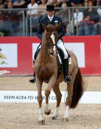 """Ulla Salzgeber, talking after victory in the Grand Prix with Herzruf's Erbe: """"My horse was very very good. Now that he is 12, he is more settled in his job and more relaxed"""". (Photo: FEI/Kit Houghton)."""