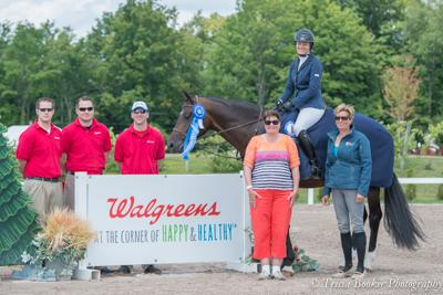 Samantha Segedy and Nandino receive their awards from the Walgreens sponsors, accompanied by owner Mrs. Ellen Malson, left, and trainer Kim Cosma Segedy