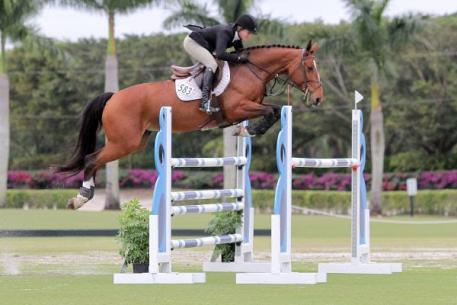 Sarah Segal and Zelda winners of 1.30m-1.35m Class Two at Week II of the Wellington Turf Tour held at the International Polo Club Palm Beach. Photo by: Kendall Bierer/Phelps Media Group