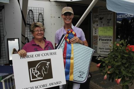 Beth Haist (left) presents Katarina Stumpf with the Horse of Course High Score Award.