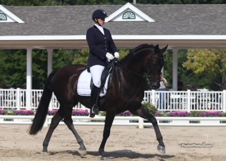 Lientje Schueler and Regalo (Rosario - Dandiell by Nandino) owned by Pinky Roberts finish third overall in the four year old division of the 2011 Markel/USEF National Young Horse Championships. (photo: phelpsphotos.com)