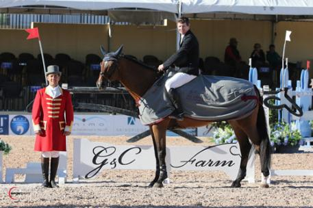 Shane Sweetnam (pictured aboard borrowed mount, Ashley Baker's HH Carotino) in his winning presentation with ringmaster Gustavo Murcia. Photos © Sportfot, An Official Photographer of the FTI Consulting Winter Equestrian Festival, us.sportfot.com.