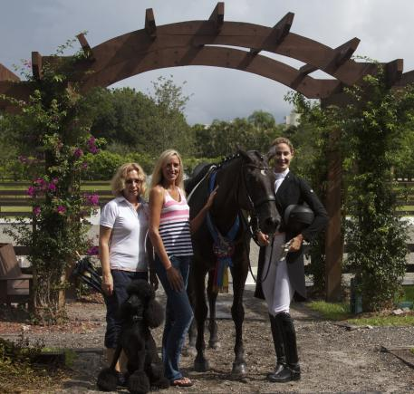 ShowChic's Michele Hundt, Arlo the poodle, and Krystalanne Shingler with Caroline Roffman and her mount, Her Highness O during the ShowChic commercial shoot. (Photo: courtesy of Sim Gottesman)