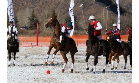 A bright red ball is used in snow polo to make it more visible on snow.