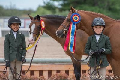 Sophie Gochman and Hi Lite, right, and Mimi Gochman and Rafael shared tricolor honors in the Small Pony Hunter section