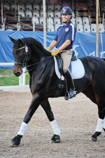 Steffen Peters happy to see an American face, photographer Diana de Rosa was there for the warm up.