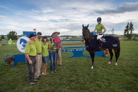 Tamie Phillips and Cristar with David, John , Joyelle, Makenzie Edwards and Pedro Cebulka after her first place win in the 0,000 Synoil Grand Prix at Rocky Mountain Show Jumping during the Rocky Mounain Classic II.