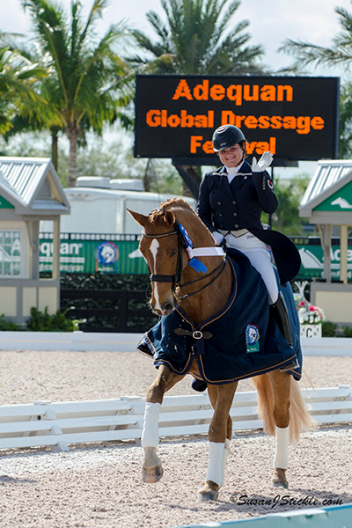 Tanya Strasser-Shostak and Action Tyme win the Young Rider Division at the 2014 Florida International Youth Dressage Championships  Photo: Betsy LaBelle