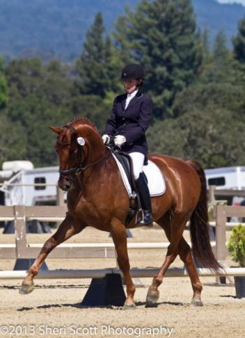 Tanya Vik and Holy Wonder's harmonious ride earn them a 74.125% in Fourth Level (Photo: Sheri Scott)