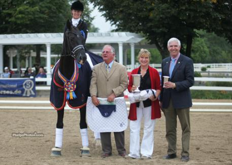 Winner of the 2012 Markel/USEF Dressage Young Horse 6-Year-Old Class, Alice Tarjan and Somer Hit with jusge Axel Steiner, Markel's Mary Phelps and John Seger.