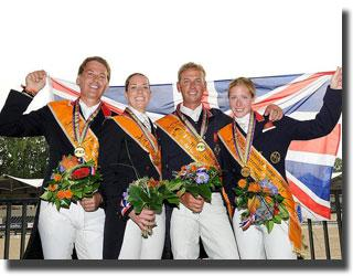 The Gold Medal British team of Emile Faurie, Charlotte Dujardin, Carl Hester and Laura Bechtolsheimer (Photo: FEI/Peter Nixon)