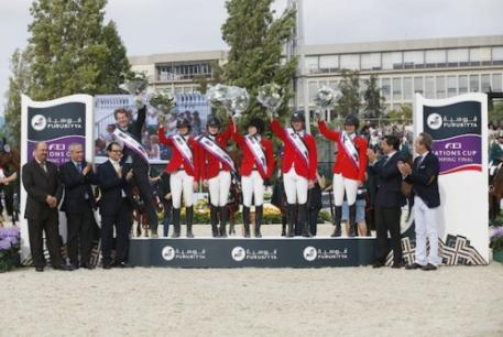 The winning USA team on the podium after the Consolation Class at the Furusiyya FEI Nations Cup™ Jumping Final at the Real Club de Polo in Barcelona, Spain today (from left) chef d'equipe Robert Ridland, Reed Kessler, Lucy Davis, Katie Dinan, McLain Ward and Beezie Madden with the presentation party of Abdul Rahman Al Hazza'a, President of the Saudi Broadcasting Corporation, Ingmar De Vos, FEI Secretary General, HH Prince Mansour Bin Khalid Alfarhan Al-Saud, Saudi Arabian Ambassador to Spain, (a