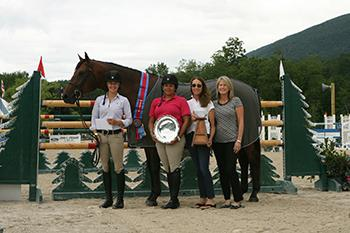 Thea Chafee is presented as the winner of the fourth annual Adirondack-Green Mountain Challenge. From left to right: Thea Chafee with INXS, Shachine Belle, Adele Einhorn, and Robin Swinderman. Photo by David Mullinix Photography