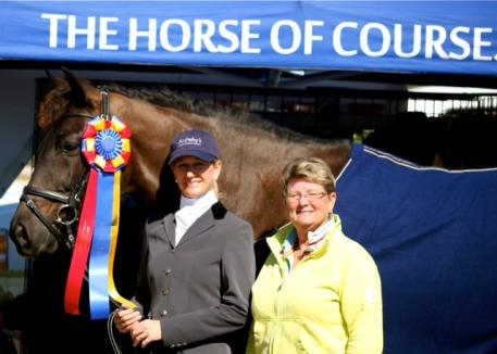 Beth Haist of The Horse of Course presents an award during the Palm Beach Dressage Derby.  The Horse of Course is known for sponsoring shows across the country and will be stepping up their sponsorship at the 2012 NEDA Fall Festival.