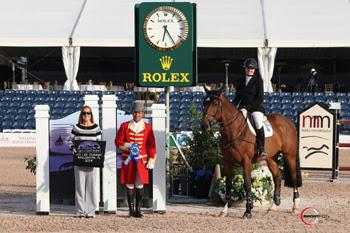 Tiffany Foster (mounted on Powerplay) is presented as the winner of the ,000 Spy Coast Farm 1.45m Speed at the 2014 FTI Consulting Winter Equestrian Festival in Wellington, FL. Photo by Sportfot