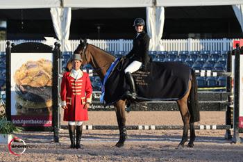 Tiffany Foster, mounted on Victor, is presented as the winner of the ,000 Ruby et Violette WEF Challenge Cup Round III – Section B by ringmaster Gustavo Murcia at the FTI Consulting Winter Equestrian Festival in Wellington, FL. Photo by Sportfot