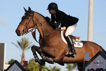 Canada's Tiffany Foster guided Victor to victory in the ,000 Ruby et Violette WEF Challenge Cup Round III – Section B on January 23 at the FTI Consulting Winter Equestrian Festival in Wellington, FL. Photo by Sportfot