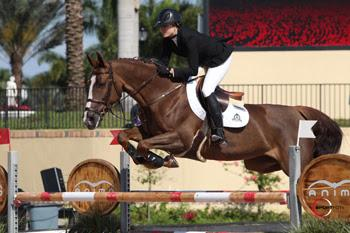 Canadian Olympian Tiffany Foster and Melody des Hayettes Z, owned by Artisan Farms, won the ,000 Spy Coast Farm 1.45m Speed on Wednesday, March 26, during the final week of the 2014 FTI Consulting Winter Equestrian Festival in Wellington, FL. Photo by Sportfot