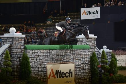 Tim Gredley and Unex Valente soar over a 7-foot LIFEFORCE Elite™ Puissance wall to claim their second win in the equestrian high jumping contest at the Alltech National Horse Show. Photo Credit: Tim Webb Photography for Alltech