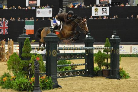 Todd Minkus and Quality Girl on their way to the win in the ,000 CSI2* Grand Prix during the 2013 Live Oak International. (Photo courtesy of Mark Astrom)