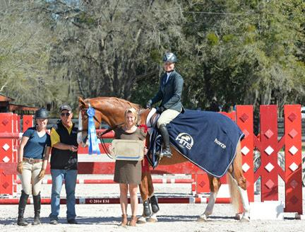 Tracy Fenney and MTM Timon are presented with winner's awards, including a Horze Equestrian cooler, after the ,000 SmartPak Grand Prix, presented by Zoetis, at HITS Ocala. ©ESI Photography