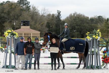 Tracy Fenney and MTM Centano are presented with winner's prizes, including a Horse Equestrian cooler, after the ,000 SmartPak Grand Prix, presented by Zoetis, at HITS Ocala. ©ESI Photography