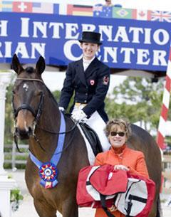 Belinda Trussel and Anton accepting first place in the CDI Grand Prix from judge Janet FoyCredit: susanjstickle.com