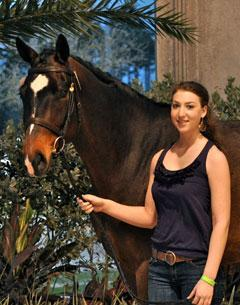 Jessica Twiggs stands with her new horse Highlife's Dakarai, which her parents bought for her at the 2010 Highlife Farm Diamond Select auction in West Palm Beach, Florida.