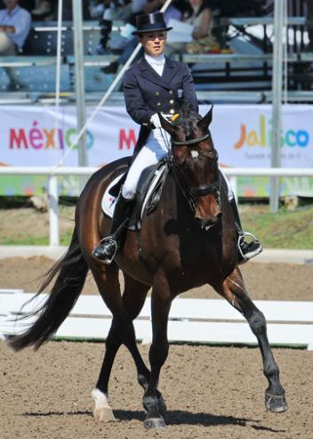Samira Uemura (DOM) on Royal Affair is a 9-year-old, 17.1 hand bay Hanoverian gelding by Royal Diamond which Eduardo and Yvonne Losos de Muniz have owned since he was a two year old.(photo: Diana de Rosa)