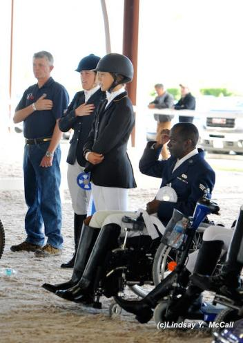 Left To Right- Kai Handt, Mary Jordan, Elizabeth Traband, and Derrick Perkins U.S. Air Force Wounded Veteran salute the U .S. flag during the National Anthem.