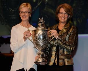 USEF President Christine Tauber presents the U.S. Equestrian Federation's 2013 Equestrian of the Year trophy to showjumper star Beezie Madden. Photo: Diana DeRosa