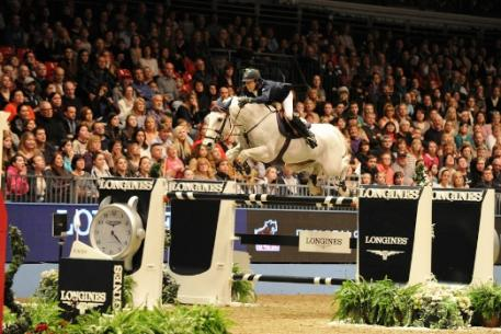 The Netherlands' Maikel van der Vleuten moved up to third place on the Western European League leaderboard when winning today's thrilling Longines FEI World Cup™ Jumping 2013/2014 qualifier at Olympia, London (GBR) with VDL Groep Sapphire B.  Photo: FEI/Trevor Meeks.