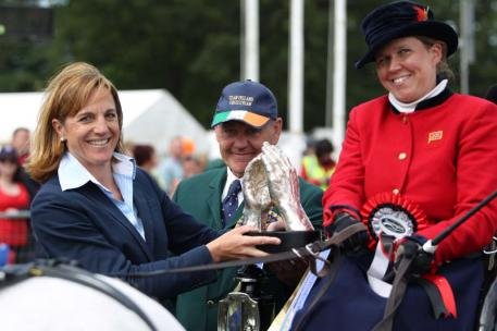 Bettina De Rham, FEI Director Driving, Vaulting, and Reining, presented the Princess Haya Hand-in-Hand Trophy to this year's winning pair consisting of para-driver Lindsey Tyas Paice (GBR) and Barry Capstick (IRL), who competed in the CAI2*. Photo: Marie de Ronde-Oudemans/FEI
